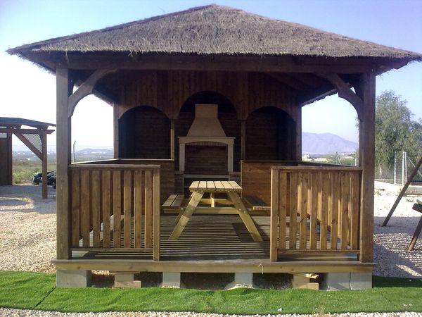 Naturmaderahogar fabricantes de casas y pergolas de madera for Fotos de kioscos de madera